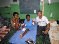 Photo of Richard Lumarque and two Haitian women, one has had one arm and one leg amputated.