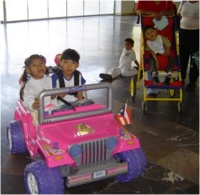 Adapted electric toy car with two children