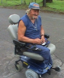 Man in power wheelchair.
