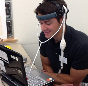 Photo of a man trying a headpointer with a keyboard.