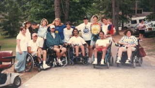 Photo of a group of campers and counselors smiling.